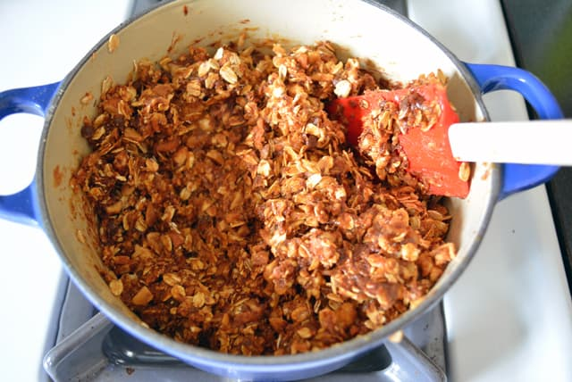 Energy Bar ingredients in a small blue pot with a red rubber spatula.