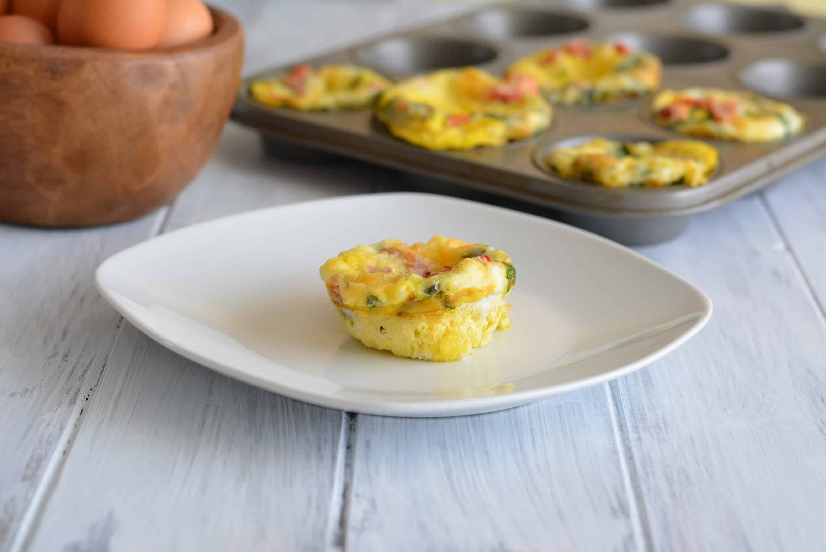 Roasted Pepper & Egg Breakfast Muffin on a white plate.