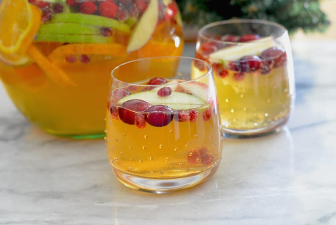 Fall inspired apple cider sangria in a stemless wine glass