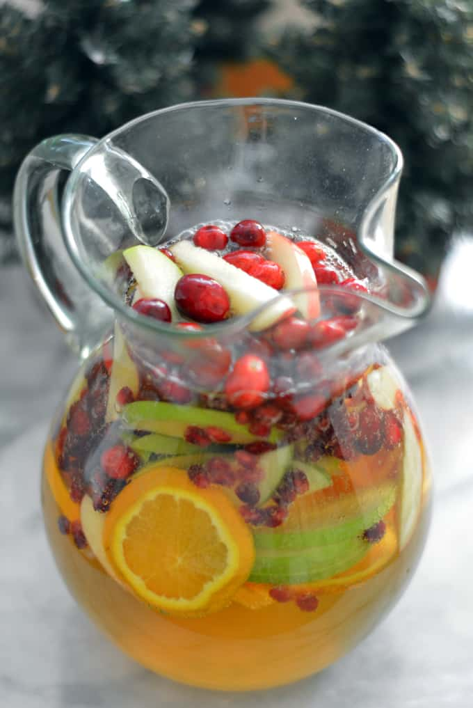 Pitcher of Sangria made with sparkling cider and fruit