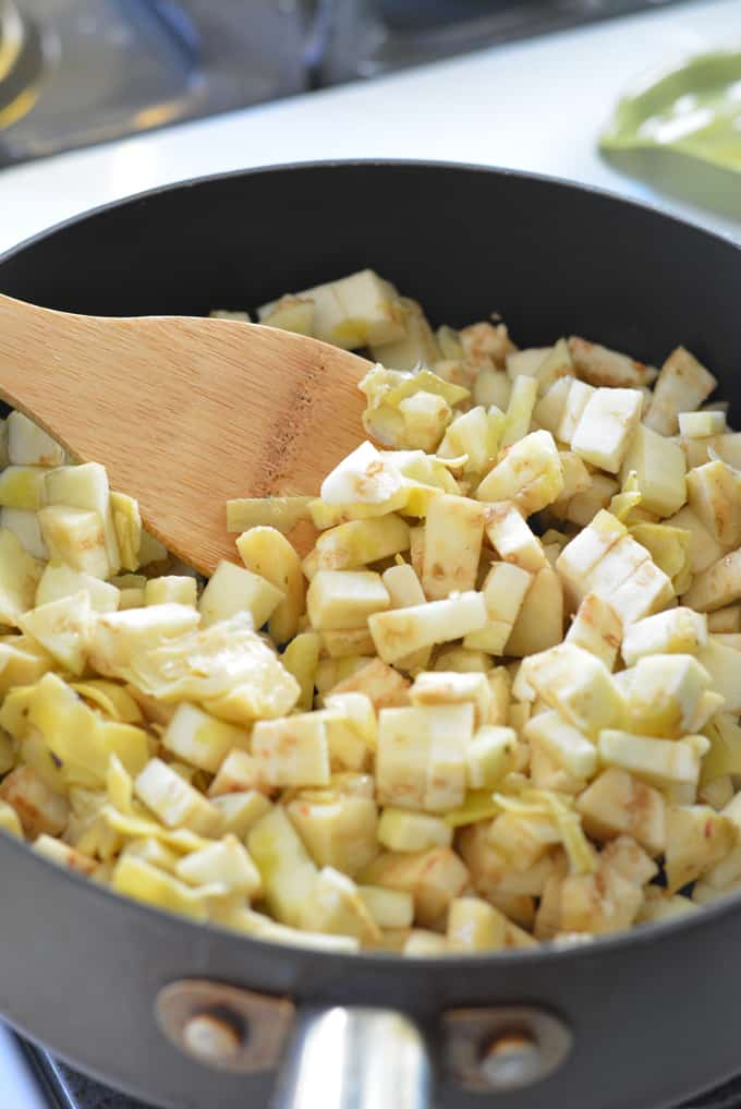 Diced eggplants in a saute pan.
