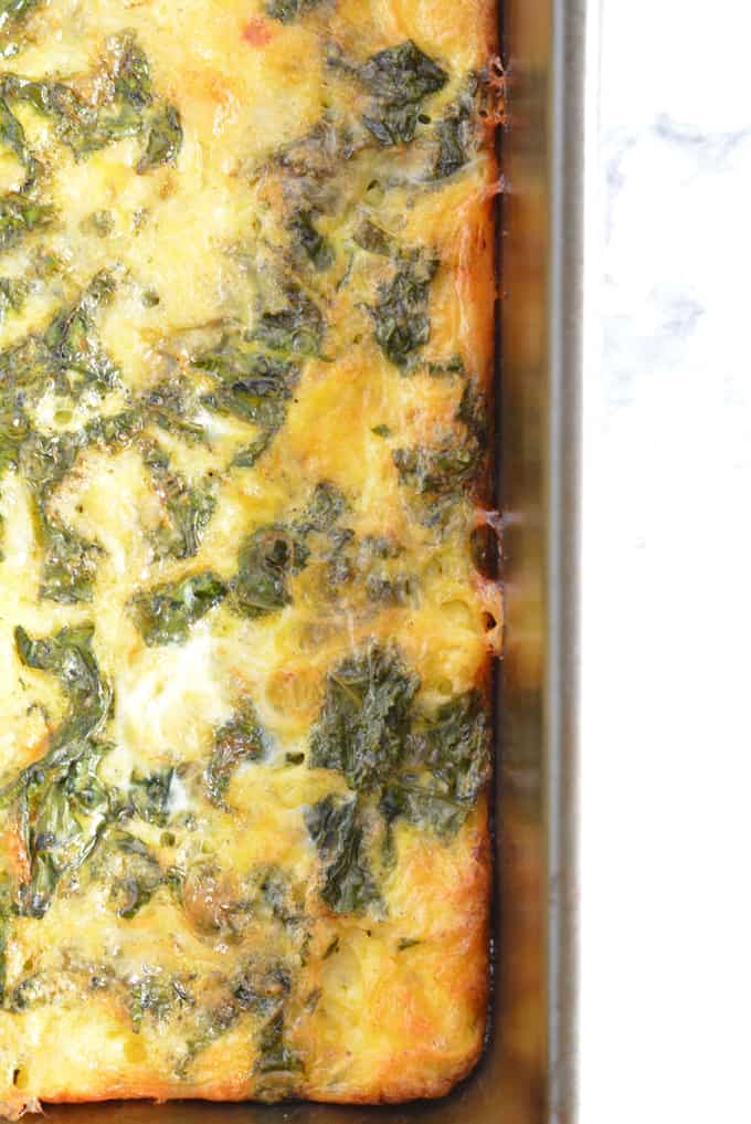 Kale and Cheddar Frittata without crust in a pan.
