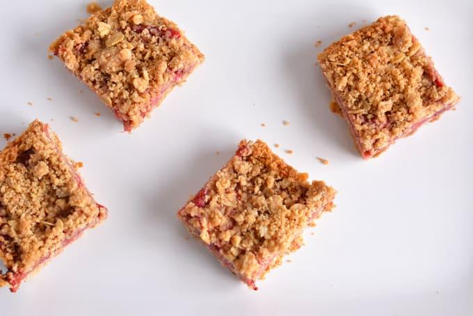 Strawberry Rhubarb Oat Crisp Bars cut into squares.