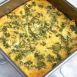 An egg frittata with kale with crust in a baking pan.