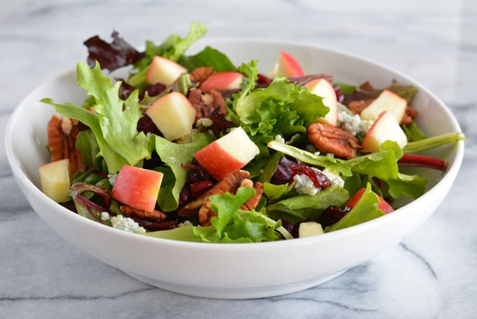 Harvest Salad with Apple Dijon Dressing is filled with the most delicious flavors of Fall. Perfect for Thanksgiving, Christmas, and any holiday party.