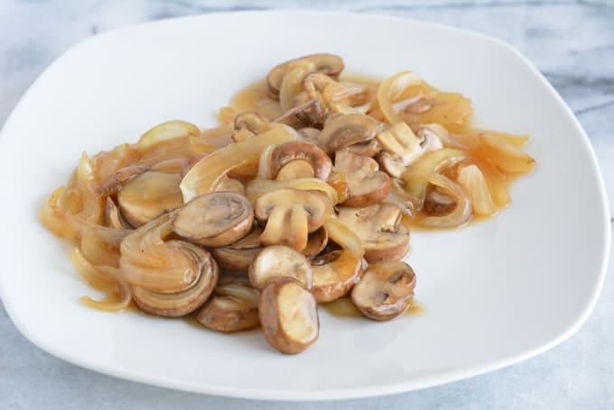 Top over your steak or beef entree with these meaty saucy mushrooms & onions.