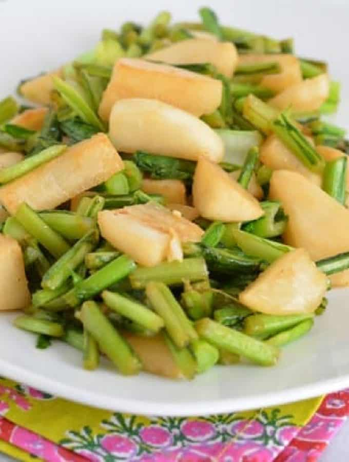 Cooked turnips on a white plate.