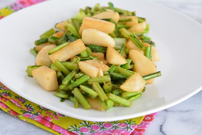 Cooked white turnips on a white plate.