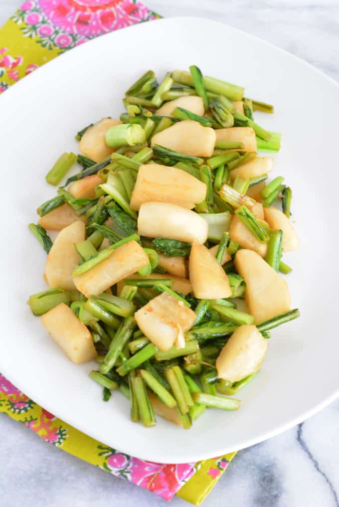 Hakurei Turnips cooked with ginger and soy on a white plate.
