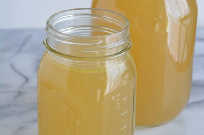 Homemade chicken broth in jars