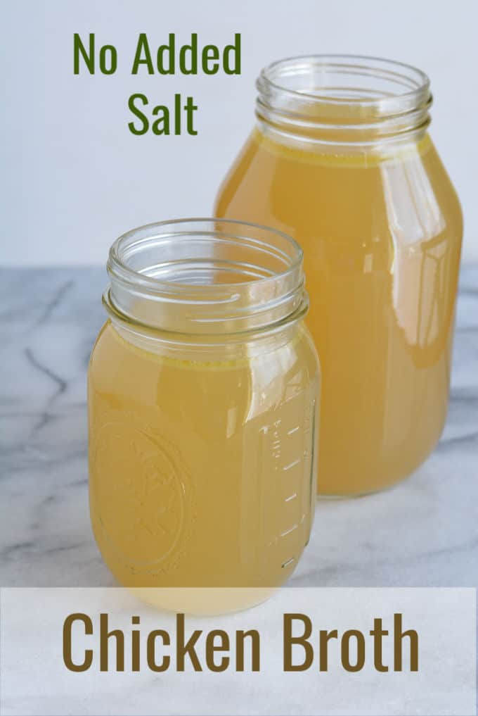 Homemade chicken broth in jars.