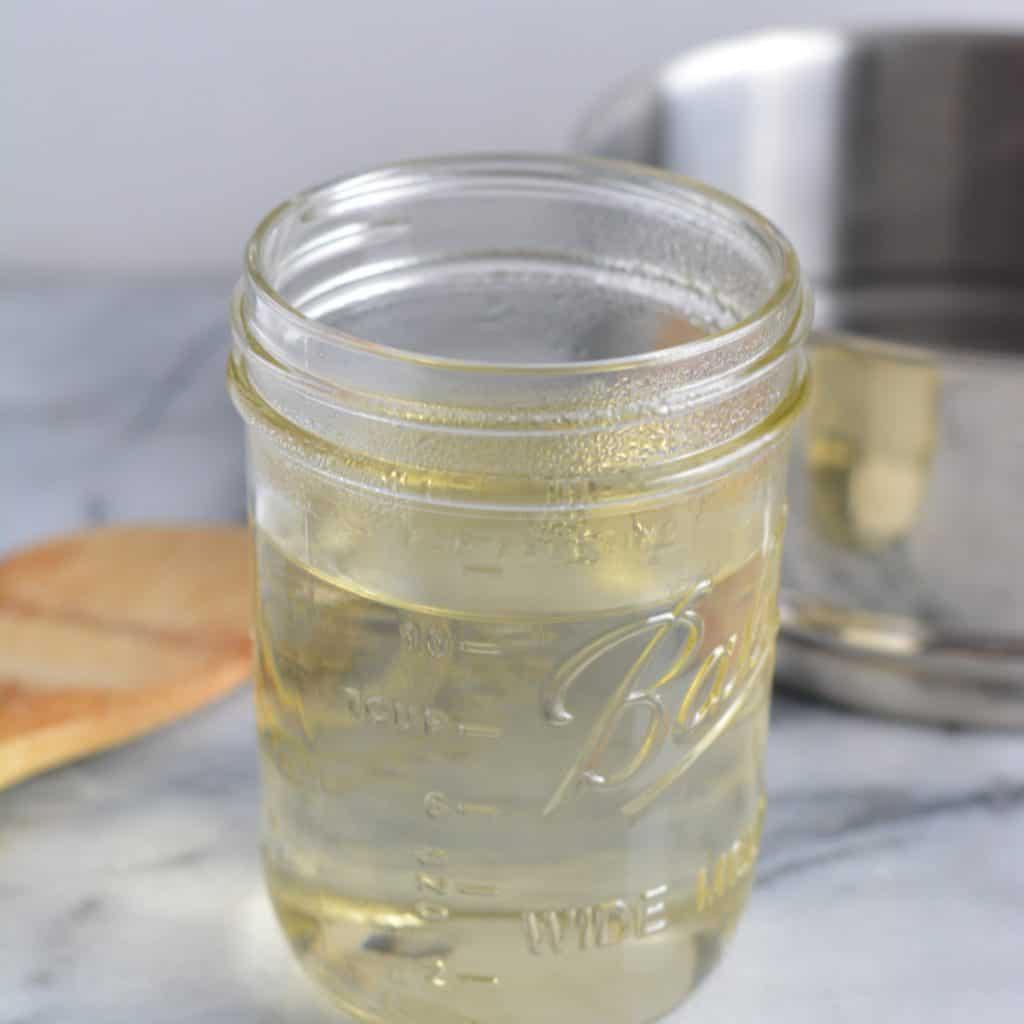Simple syrup in a mason jar.